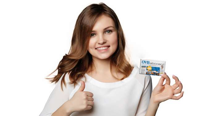 Smiling business woman showing blank credit card and giving appr
