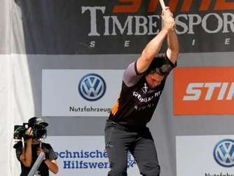 Peter Bauer performs at the underhand chop during the Stihl Timbersports Series German Championship in Cologne, Germany on Sunday 30th of August 2015